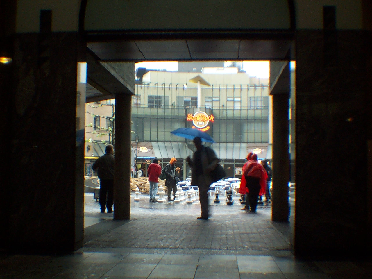 Passageway with Blue Umbrella